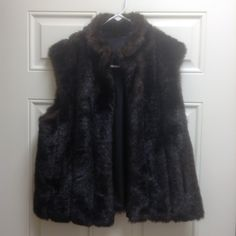Faux fur reversible vest Dark brown faux fur vest with dark vinyl-like reversible liner? Jackets & Coats Vests