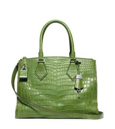 """""""In my designs I'm constantly striving to create something that's a balance of function and fantasy,"""" says Michael. Rendered in genuine crocodile skin, the Casey satchel is luxury in its finest form. This beautiful bag features ample interior compartments, while the refined exterior is accented with lock-and-key hardware and an understated logo."""