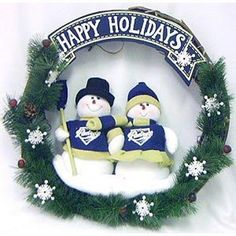 """San Diego Padres MLB 20"""" Team Snowman Wreath by Caseys. $38.46. SC Sports MLB Holiday Wreaths. This team snowman Christmas wreath is accented with pine cones, holly berries and two snowmen dressed in official MLB team colors with an authentic logo. The wreath is 20 inches in size. Perfect for your holiday home décor, or to give as a gift to your favorite sports fan!. This team snowman Christmas wreath is accented with pine cones holly berries and two snowmen dre..."""