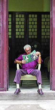 Reading in the doorway People Around The World, Around The Worlds, In This World, Cuban People, Caribbean Culture, Cuba Travel, Maritime Museum, Dirty Dancing, Havana Cuba
