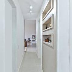 Corredor: Corredores, halls e escadas modernos por Mendonça Pinheiro Interiores