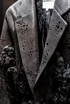 Perforated leather jacket with disheveled embellishments; fabric manipulation; fashion design detail // Noir Kei Ninomiya