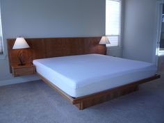 Cherry floating platform bed with slant back headboard