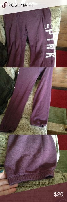 Pink by VS jogger sweatpants maroon color Great used condition. Cinched at bottom. Emblem intact. Two pockets on each front side and drawstring inside. PINK Victoria's Secret Pants Track Pants & Joggers
