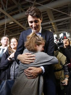 """Hannah Aris, 10, asked Trudeau for a photo as soon as he was close. """"He quickly agreed and as he lifted his arm to put around her, she dove in for a massive hug,"""" her father, Dan, told BuzzFeed Canada. This was the adorable, teary result:   This Photo Of A Young Girl Hugging Her """"Hero"""" Justin Trudeau Will Give You All The Feels"""