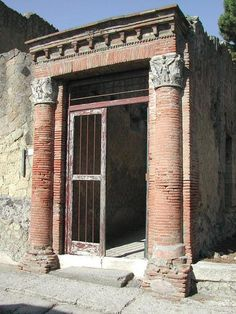 A Roman house in Herculaneum. Herculaneum (in modern Italian Ercolano) was an ancient Roman town destroyed by volcanic pyroclastic flows in 79 A.D., located in the territory of the current commune of Ercolano, in the Italian region of Campania in the shadow of Mt. Vesuvius.