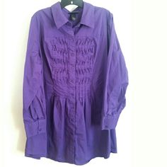 """Lane Bryant 18/20 Purple Cotton Button Up Tunic This Lane Bryant 18/20 Purple Cotton Button Up Tunic is in good used condition. It's a great length to cover your bum. 97% cotton fabric with some stretch. Bust measures 24"""" across laying flat, measured from pit to pit, so 48"""" around. 32.5"""" long. ::: Bundle 3+ items from my closet and save 30% off when you use the app's Bundle feature! ::: No trades. Lane Bryant Tops Tunics"""