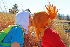 Finn and Flame Princess from Adventure Time.