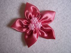 Satin fabric flower. I followed this tutorial http://www.youtube.com/watch?v=9KasSyFbvK0&feature=related