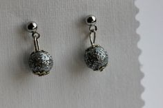 Beautiful, sparkling earrings the light up your day! Handmade.