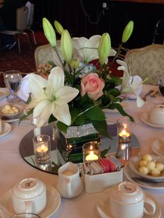 Peach & periwinkle centerpiece for 90th birthday celebration.  Sanramonweddingflowers.com
