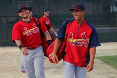 St. Louis Cardinals Yadier Molina and Jon Jay walk out to the practice field to begin their workout at the Cardinals spring training complex...