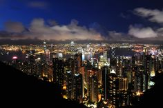 Hong Kong: view from Victoria Peak looking over Kowloon & Victoria Harbor at night.