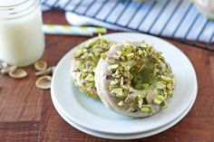 Baked Pistachio Doughnuts (flour, sugar, pistachio pudding mix, b.powder, b.soda, milk, egg, oil, almond extract, pistachios, powdered sugar, honey)