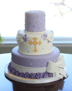 Baptism cake with sugar flowers, fondant ribbon and hand cut cross. Could also be used for First Communion, Confirmation, Ordination, Priest Retirement First Communion Cakes, First Holy Communion, Bautizo Cakes, Comunion Cakes, Religious Cakes, Confirmation Cakes, Fondant Cookies, Gateaux Cake, Occasion Cakes