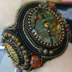 Red Creek Jasper is beautifully complimented by the seedbead colors masterfully chosen by Danaelle Mason of D'Nell's Beaded Creations. What a stand-out cuff!