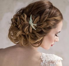 Braided updo with a bird head piece by Heather Chapman Hair