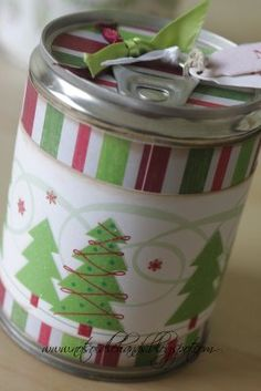 pop-top can that has been emptied from the bottom, refilled with treats, glued back on and decorated.  such a clever gift idea.
