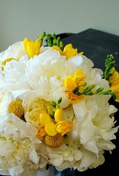 Bouquets of Austin: June bouquets. Freesia with craspedia and white