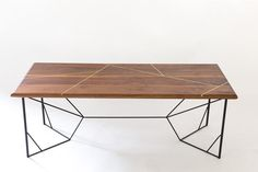 New Design: Looking for something more than your usual coffee table? We have you covered! Stunning solid brass geometric inlays criss cross the surface of this solid walnut coffee table, perched atop