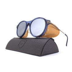 The Matsuda | M1013 is a representation of Matsuda's steam punk influences. This form fitting frame features a zero base curve mirrored lens as well as detachable leather side shield fastened by a titanium insert. Available in 2 colors.