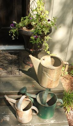 More Powerful Beyond Measure My watering cans on side porch