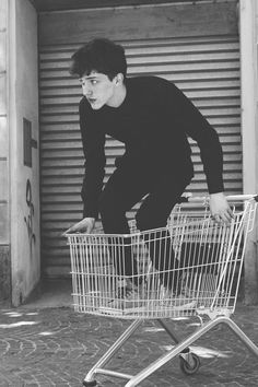 """What the hell are you doing Cole,"" Echo growled, ""What is that thing anyway?"" Cole laughed, ""It's called a shopping cart; and I honestly don't know anymore. But it's a shopping cart, and I want to race somene in this thing!"""