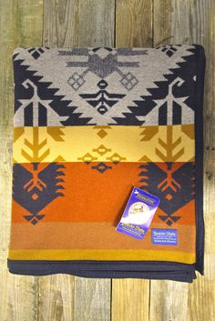 PENDLETON Charbonneau Blanket $228.00 This beautiful blanket, woven in our American mills, is named after Jean Baptiste Charbonneau. Jean Baptiste was the son of Shoshone guide Sacagawea and French Canadian trapper Toussaint Charbonneau. As the youngest member of the Lewis and Clark Expedition—and quite possibly the most important—he unwittingly protected it from attacks.