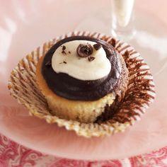 Irish Cream ganache tops these tasty black and white cupcakes. More St. Patrick's Day desserts: http://www.bhg.com/holidays/st-patricks-day/recipes/delicious-st-patricks-day-desserts/?socsrc=bhgpin031113irishcreamcupcakes=13