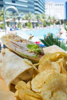 No need to compromise between lunch and pool time. Enjoy poolside plates at Bamboo Pool, like the Roasted Turkey Club Wrap. #yum #VegasEats