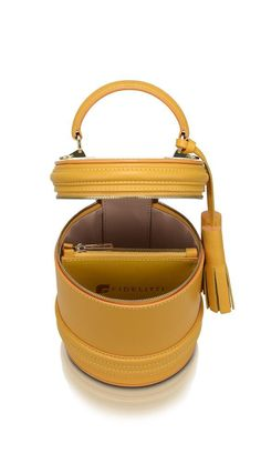 • Goldenrod color • Materials: Brunto calfskin trim with natural face • Zip fastener • Removable long strap on carabiners • Branches / pockets (internal): 1 com