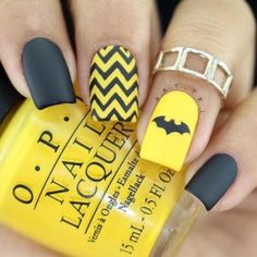 Batman Design Of Yellow Nails. Nails Can Be Super Hero Too!Yellow is sunny, warm and beautiful. Many women would love to experiment with yellow nail art. However there are times when you might just not know how to go about painting your nails yellow without looking too awkward.