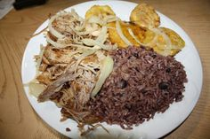 Lechon asado, moros, y tostones --- One of several traditional Cuban meals