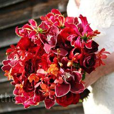 gloriosa lilies, cymbidium orchids, mokara orchids, roses, ranunculas - beautiful mix