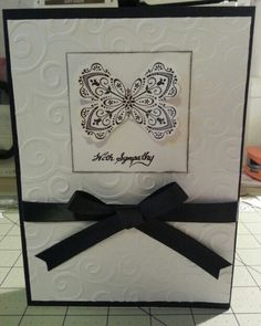 Stampin' Up Sympathy card. Basic black and whisper white card stock. D'vine swirls embossing folder with basic black ribbon and stamp set using Mixed Bunch stamp which I punched and cut into a butterfly shape using the blossom punch and accented with jewel basic rhinestones. All items can be purchased via my stampin up store: http://www.stampinup.net/esuite/home/acard4you Thanks