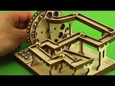 Manual KIT - Modular Marble Machine - Shield no.1 - YouTube Rolling Ball Sculpture, Wood Crafts, Diy And Crafts, Puzzles, Marble Machine, Marble Games, Diy Robot, Church Design, Cube Storage