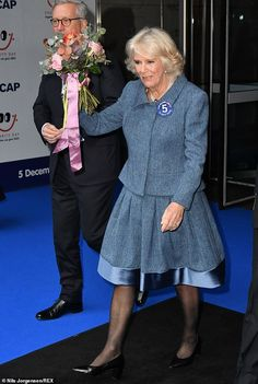 The Duchess held the flowers aloft to well-wishers as she left the event at the Broadgate offices this morning Camilla Duchess Of Cornwall, Herringbone Coat, Camilla Parker Bowles, Hm The Queen, Prince Charles And Camilla, Royal Engagement, Lady Diana Spencer, Queen Elizabeth Ii, Classy Women