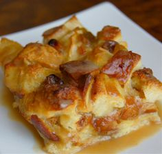 Rum and Raisin Bread Pudding with Rum Sauce...sooooo good. Tried this tonight with some week old leftover Tuscan bread from Federico's. Sorry birds, no more stale bread for you!