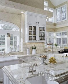 Light, bright kitchen with lots of windows! Herbeau Namur prep faucet on island