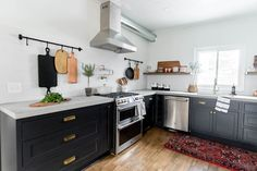 Ashley of the blog Cherished Bliss transforms her historic kitchen into a rustic modern space using black, inset cabinetry.