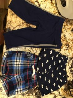 Navy shark detail shorts have never been worn, plaid shorts were worn twice and sweat pants used 4 times. Adorable and ready for their new home. Plaid shorts are size 6 month but run small in my opinion and can be worn earlier. Other bottoms are size 3-6 months.