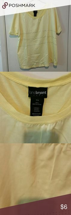 Lane Bryant yellow tee This tee has a cotton back, but satiny-feel in the front. Very small stain near neckline (see 3rd picture) but I think it would come out. Gently used. Lane Bryant Tops Tees - Short Sleeve