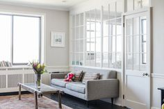A Sweeten renovation transformed a living room and alcove with a wall of windows - one of the loveliest space-saving solutions we've seen yet! Interior Windows, Bedroom Windows, Living Room Windows, New Living Room, Interior Walls, Living Spaces, Dispositions Chambre, Transom Windows, One Bedroom Apartment