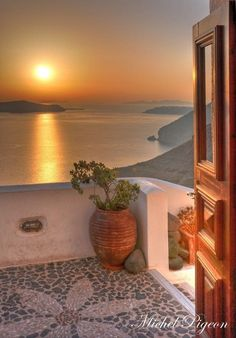 Sunset in Santorini by Michel Pigeon