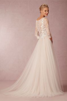 Amelie Gown from BHLDN quite modest and elegant. just dont look at the price.