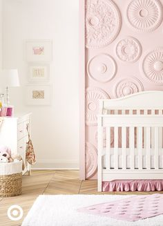 Looking for nursery inspiration for your baby girl? This dreamy pink-and-white nursery is furnished with pristine white classics: the Eddie Bauer Langley 3-in-1 convertible crib and matching 6-drawer dresser. A pink polka dot accent rug layered over a soft white area rug completes the sweet look.