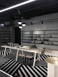 French designer Aurélien Barbry has installed a pattern of black and white stripes across the floor of Hong Kong beauty brand Facesss' Harbour City store.