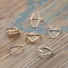 Gold Rings by Glee Jewelry . #goldobsessed #gold #rings #getglee #jewelry #arrow #heart #amore #hammeredjewelry
