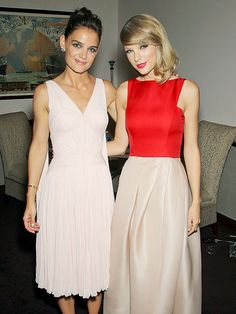 Star Tracks: Tuesday, August 12, 2014 | MEETING OF THE MINDS | Katie Holmes and Taylor Swift have the perfect pose down Monday night at the New York City premiere of their new film, The Giver.
