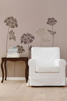 Simple and understated - flower silhouettes on a greige wall.